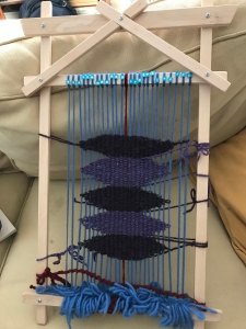 hand loom with warp and weft strung to create the Bowl